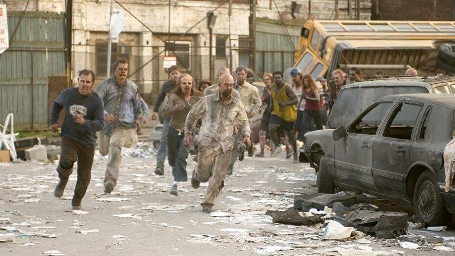 savaş alanına dönmüş bir sokakta zombiler koşuyor